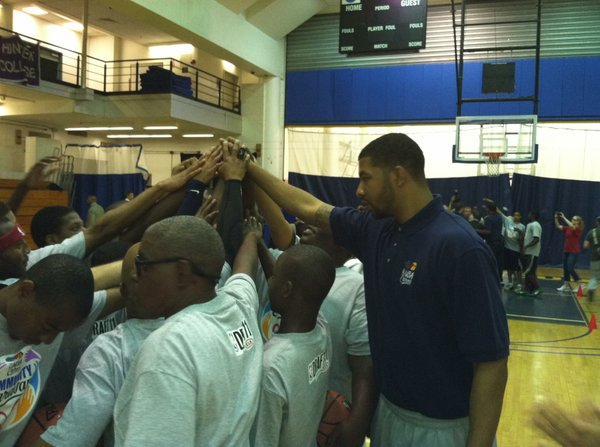Markieff Morris huddles up with participants at an NBA Cares event in New York on Wednesday, June 22, the day before the 2011 NBA draft.