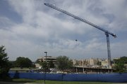 A crane lifts material for a new 34,600-square-foot engineering building on the Kansas University campus, which will house a number of multidisciplinary research laboratories.