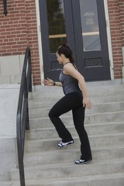 Lovena Tuley runs laterally up stairs. Stair repeats are great for burning calories for those trying to get in shape for the summer.
