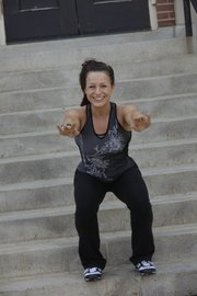 Lovena Tuley does squats on stairs during an outdoor workout. If you're a beginner, Tuley recommends lightly holding a stair railing for support. Once you've got that down, you can do them free-standing.