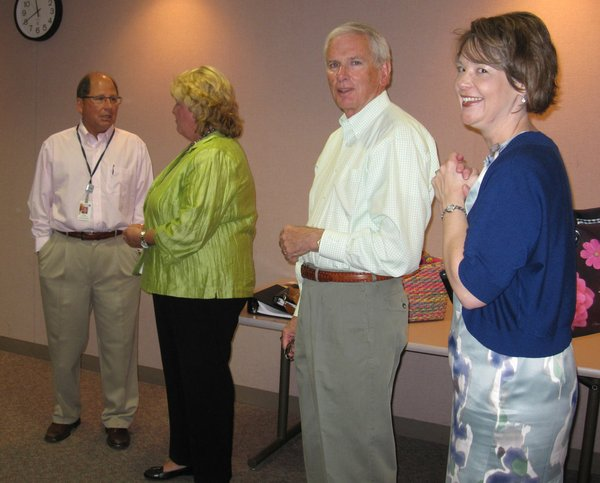 From left are Lawrence Memorial Hospital President and CEO Gene Meyer; Jane Blocher and Chuck Heath, LMH board members; and Assistant City Manager Cynthia Wagner. They were visiting before a luncheon Thursday at LMH.
