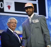 NBA Commissioner David Stern, left, stands with the No. 13 pick, Kansas' Markieff Morris, who was selected by the Phoenix Suns in the NBA basketball draft Thursday, June 23, 2011, in Newark, N.J.
