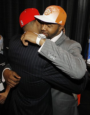 Twin brothers Markieff, right, and Marcus Morris, who played together at Kansas, embrace each other after they were picked No. 13 and No. 14, respectively, during the NBA basketball draft, Thursday, June 23, 2011 in Newark, N.J. Markieff was picked by the Phoenix Suns while Marcus was picked by the Houston Rockets.