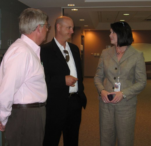 City commissioner Hugh Carter, center, visits with Allen Belot, Lawrence Memorial Hospital boar member, left, and Karen Shumate, LMH chief operating officer, before an informal luncheon Thursday, June 23, 2011, at LMH.