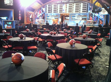 A Basketball And Drink Sit On Each Table In Front Of The Stage At The 2011  NBA Draft.
