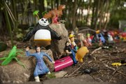 Various figurines like the Kung-Fu Panda assemble along the rocks of Funkytown.