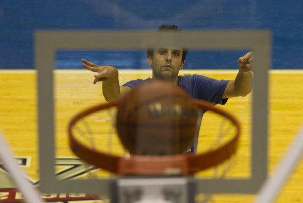 John Henderson, of Lawrence, sinks a free throw during the Hoops for Men's Health free throw competition held Sunday, June 26, 2011 at Allen Fieldhouse.