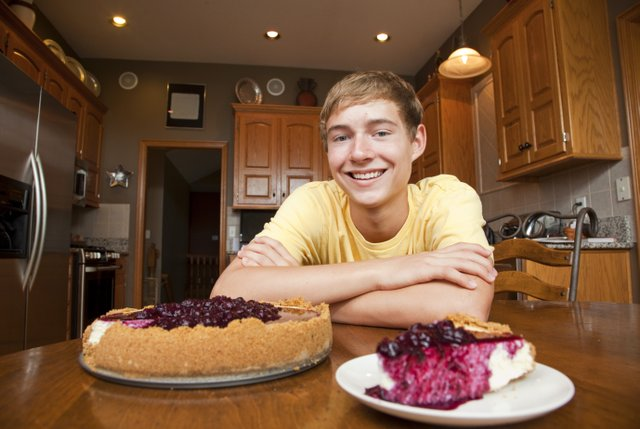 Lawrence teen Andrew Pester, a Free State High School junior, is pictured with his Blueberry Cheesecake. Pester says that he uses cinnamon in his crust and also a combination of goat cheese and cream cheese for the filling.
