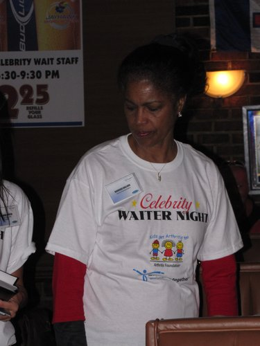 State Representative Barbara Ballard (D) attends to her customers at the Celebriaty Waiter event at Henry T's.