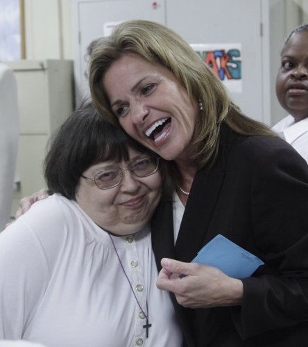U.S. Rep. Lynn Jenkins, right, gives Cottonwood employee Diana Gates a hug after receiving an award Monday for her advocacy and work on behalf of people with disabilities.