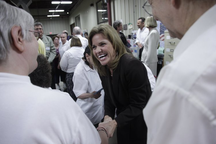 U.S. Lynn Jenkins shares a laugh with employees Monday at Cottonwood Inc., 2801 W. 31st St. She received the AbilityOne Champion award from Cottonwood for her commitment to improving the lives of Americans who have significant disabilities.