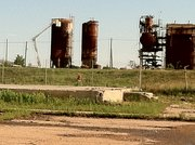 Tanks at the former Farmland Industries site are prepared for removal.