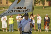 Calvin Janis, U.S. Army veteran, carried the Haskell Indian Nations University flag at the opening march. The Haskell University Upward Bound program hosted a powwow Thursday to create the largest round dance on record in Kansas. Other Upward Bound groups from around the region participated in the event.