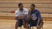Kansas basketball players Thomas Robinson, left, and Ben McLemore share a laugh during a break at the Brett Ballard Basketball Camp in Baldwin on Thursday, June 30, 2011.