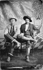 Two unidentified cowboys.