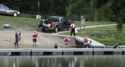 Douglas County Underwater Search and Recovery Team members search the swim beach area at Lone Star Lake for a missing seven-year-old Kansas City, Mo. boy on Saturday, June 2, 2011. The crew suspended their search for the night due to darkness and will resume at first light on Sunday.