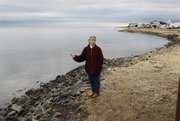 In this Feb. 24, 2010, picture, Regina Discenza stands on the shore of Barnegat Bay, near her home in Lacey Township, N.J., as she talks about the fears of water discharged from the nearby Oyster Creek nuclear plant. At the 41-year-old facility in southern New Jersey, the country's oldest operating reactor, the latest tritium troubles started in April 2009, a week after it was relicensed for 20 more years. None has been directly measured in drinking water, but it has been found in an aquifer and in a canal discharging into nearby Barnegat Bay. The bay is a popular spot for swimming, boating and fishing.