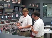 Nuclear reactor operators Chris Heinz, left, and Roger Patterson check steps that need to be taken as they practice an emergency scenario on a simulator of a digital control panel at Oconee Nuclear Station in Seneca, S.C., March 30, 2011. The nuclear plant will be the first in the U.S. to install an all-digital control panel for one of its reactors.