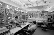 This April 8, 1983, photo shows people in the control room of the Indian Point nuclear power plant in Buchanan, N.Y. Commercial nuclear reactors in the United States were designed and licensed for 40 years. When the first ones were being built in the 1960s and 1970s, it was expected that they would be replaced with improved models long before those licenses expired. Instead, 66 of the 104 operating units have been relicensed for 20 more years, mostly with scant public attention. As of 2011, renewal applications are under review for 16 other reactors. Applications to extend the lives of pressurized water units 2 and 3 at Indian Point, each more than 34 years old, are under review by the NRC.