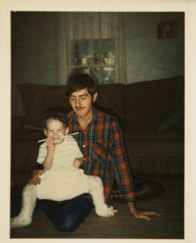 Karrey Britt with her father, Dan, wearing a frog-leg cast.