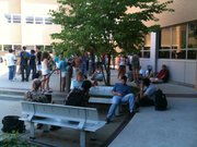 Students try to find shade outside of Learned Hall after being evacuated on Thursday, July 14, 2011. A HazMat incident was called after people reported smelling a rotten egg odor.