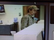 This photo shows the suspect involved in robbing Great Southern Bank in Ottawa. The bank was robbed at approximately 10:05 a.m. Friday, July 15, 2011.