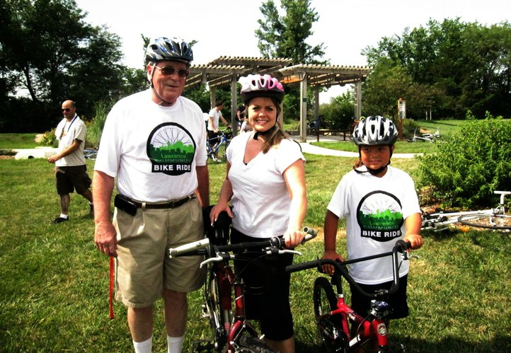 Lawrence's first Community Bike Ride drew three generations of riders. From left, are Bob Swan, 69, with his daughter Amy Swan, 35, and granddaughter Maya Morris, 8, all of Lawrence.