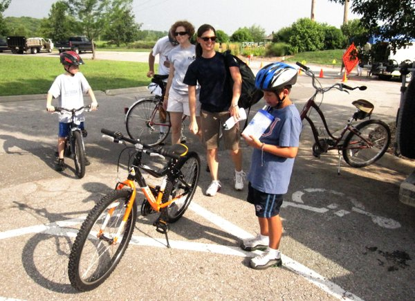 Melissa Hoffman, and her son, Braden, 7, foreground, attend the Community Bike Ride in 2011. Braden, who just got a new bicycle, was gearing up for the one-mile ride.