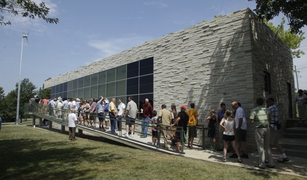 A ribbon cutting is held on KU's West Campus for the new KU Center for Design Research. The building, which showcases many renewable technologies, was built by KU students in the Studio 804 class.