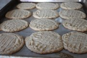 Fork marks are recommended for peanut butter cookies to help the stiff dough cook evenly. It also helps warn those who are allergic to peanut butter.