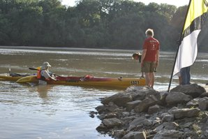 Joe Baisa, of St. Louis, pulls his canoe out of the Kansas River on Saturday afternoon. Baisa was one of nearly 200 paddlers who participated in the first ever Kawnivore 100, a 100-mile race down the river.