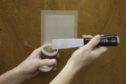 Fixing a '60s-style hollow core door is an easy fix. A screen mesh is put over the hole, and a bonding material is spread over the mesh in several coats and sanded down till a smooth finish is completed.
