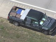 In this image from video provided by KMBC-TV, an aerial view shows a suspect's pickup truck which was stopped by Highway Patrol on Interstate 70 west of Topeka, Kan., Monday, July 25, 2011. The suspect was returned to Junction City for questioning by police and the FBI, while the interstate was closed in both directions to keep other vehicles away as authorities prepared to inspect the truck for hazardous materials.