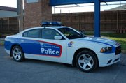 A new Kansas University Public Safety Dodge Charger idles in the Parking Lot of Oliver Hall. The department will receive three more identical cars.
