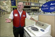Larry Stone, senior executive vice president of operations, shows some of the appliances in a Lowe's store in Elkin, N.C. The home improvement retailer has filed a new set of plans to build a store in northwest Lawrence near Sixth Street and Wakarusa Drive.