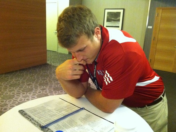 Kansas tight end Tim Biere reads over the KU media guide on Tuesday morning at Big 12 Media Days at the Westin Galleria in Dallas.