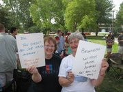 Gloria Phenix (left) and Marilyn Ault, both of Topeka, display signs on Saturday at a rally to support school funding. The rally was held outside the Capitol.