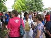 State Rep. Barbara Ballard (left) and State Board of Education Commissioner Sue Storm, D-Overland Park, talk Saturday during rally in support of public schools.