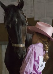 Lakin Cunningham, 8, Baldwin City, waits with her 17-year old Welsh pony,  Love Bug, Saturday at the 4-H Horse Show at the Douglas County Fairgrounds, 2110 Harper St.