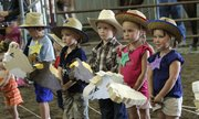 Competitors dressed the part in a special stick-horse contest for those too young to ride a real horse.