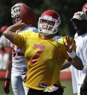 Kansas City Chiefs quarterback Matt Cassel (7) fires a pass to a teammate during training camp on Sunday in St. Joseph, Mo. The Chiefs will enter the season without a proven backup quarterback behind Cassel.
