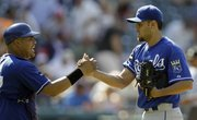 Kansas City relief pitcher Joakim Soria, right, is congratulated by catcher Brayan Pena after closing out the game against Cleveland. The Royals defeated the Indians, 5-3, on Sunday in Cleveland.