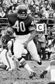 Bears running back Gale Sayers (40) carries the ball in this Nov. 10, 1970, file photo against San Francisco in Chicago. Current players still remember and idolize the former Kansas University standout, as evidenced by Texas A&M running back Cyrus Gray.