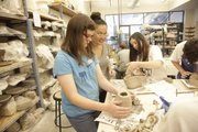 Elise Ruhlman, 13, Lawrence receives instructions from visiting artist Akiko Jackson during a Sculpting with Clay course at the Lawrence Arts Center.