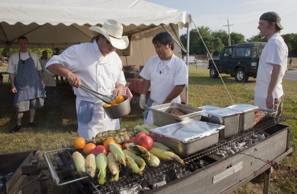 From left in foreground Alejandro Lule, and Subarna Bhattachan, of Zen Zero, begin grilling food Thursday, Aug. 4, 2011, during the Chef's Challenge at the Douglas County Fair. Chefs from three Lawrence restaurants, including Free State Brewery and Pachamamas, competed in the event using locally-grown produce. In background at far left is Pachamama chef Ken Baker and at right is Hal Beckerman, kitchen manager at Free State Brewery.