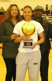 Asia Boyd, center, with parents Alanna, left, and Shawn Sr.
