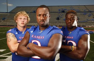 KU linebackers Huldon Tharp, left, Darius Willis and Steven Johnson.