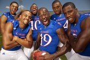 The Jayhawk secondary, clockwise from center, are Isiah Barfield, Tyler Patmon, Keeston Terry, Corrigan Powell, Bradley McDougald and Greg Brown.