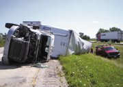 "A damaged semitrailer is seen Thursday morning, Aug. 11, 2011, after a collision with a tour bus carrying Nickelodeon actress and singer Miranda Cogrove, 18, along Interstate 70 near Vandalia, Ill., 70 miles northeast of St. Louis. Cosgrove broke her ankle in the accident. A spokesperson says Cosgrove's ""Dancing Crazy Summer Tour"" is postponed until further notice. She was scheduled to perform Friday in Wichita and Saturday in Denver."