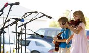 John Cary, 7, plays the guitar while his sister Grace, 10, plays the violin in the talent show Thursday, Aug. 11, 2011, at the Vinland Fair. Both are from Olathe.
